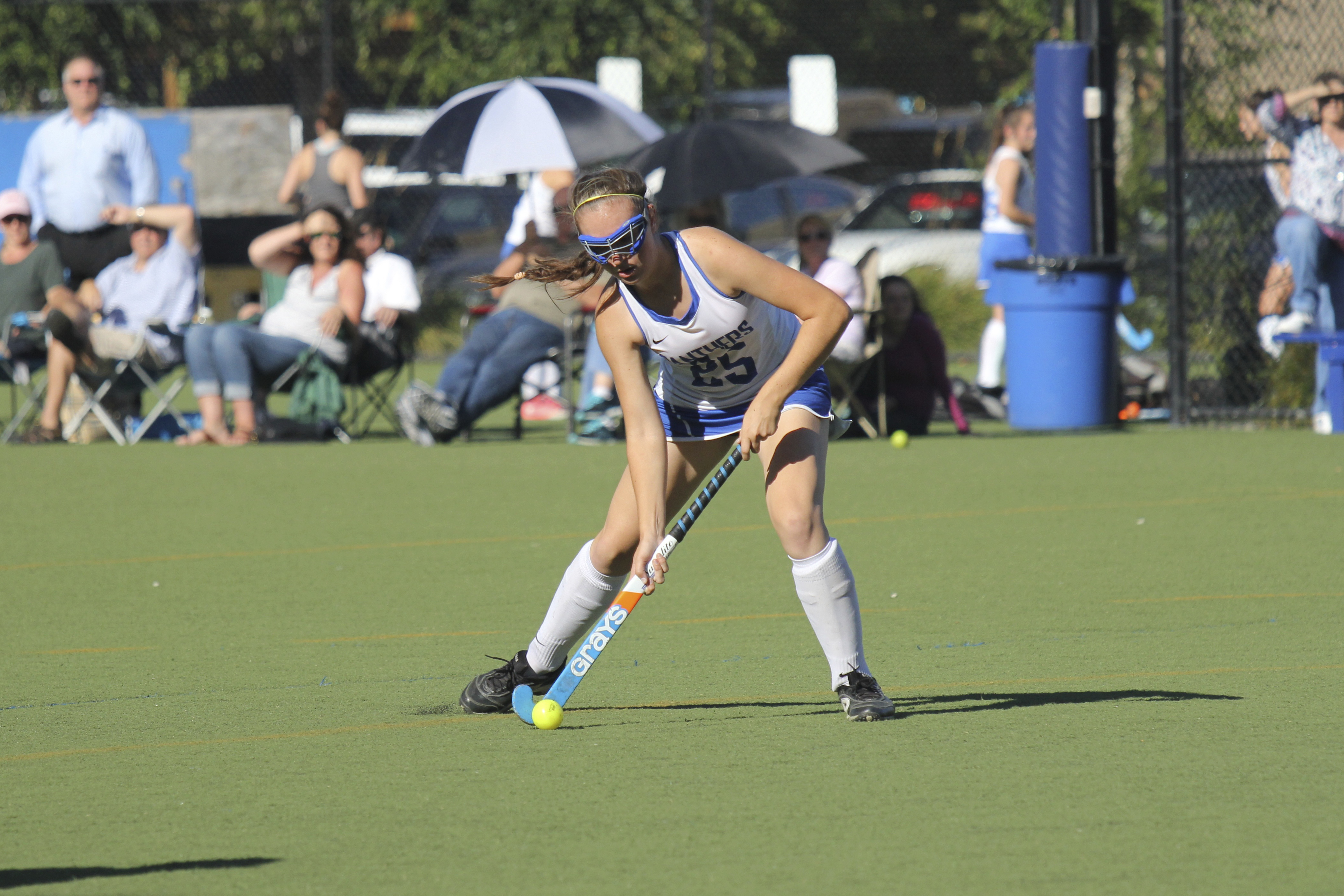 Student playing field hockey at Presentation